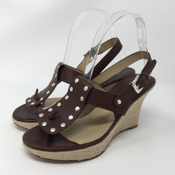 549871fb405211 Michael Kors Shoes - Michael Kors Brown Leather Studded Wedge Sandals 7